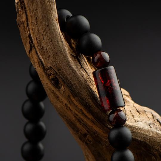 bransoletka męska z czarnymi kamieniami i bursztynem